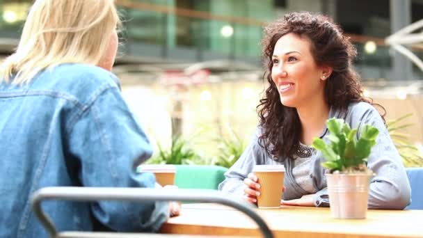 Women having a coffee together and chatting