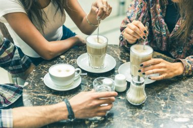Multiracial group of friends having a coffee together