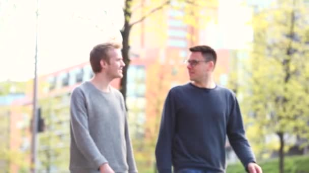 Two men walking and laughing together