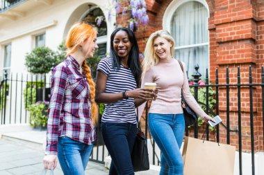 Women walking and laughing in London