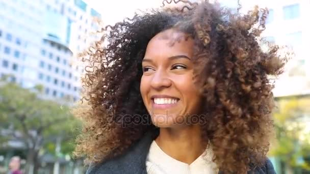 Curly woman laughing and shaking head, slow motion