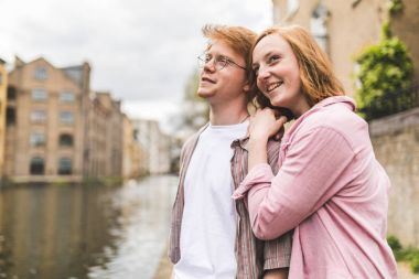 Red hair couple portrait on canalside