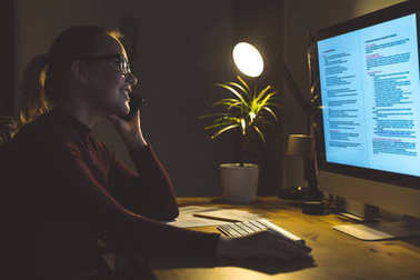Woman working at computer at home office