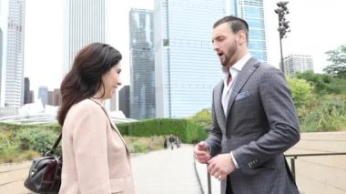 Business woman and man giving handshake in Chicago