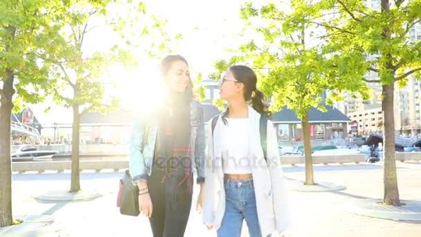 Girls best friends walking together in Toronto