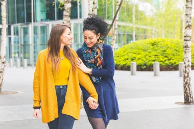 Lesbian couple in Berlin walking and holding hands
