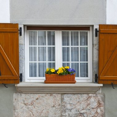 Window  Decorated With Fresh Flowers