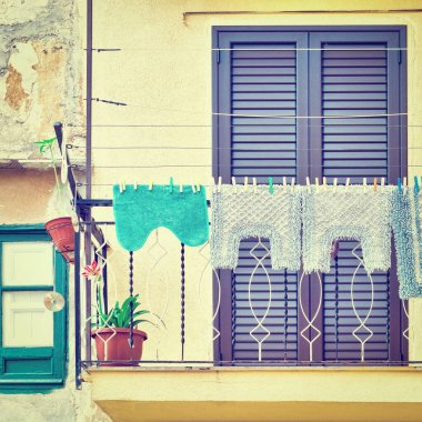 Italian Balcony in Palermo with Closed Wooden Shutters, Decorated with Mats, Instagram Effect