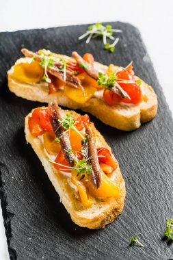tomato and anchovy crostinis