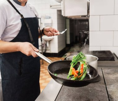 chef cooks on kitchen