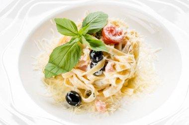 Creamy Italian pasta in plate