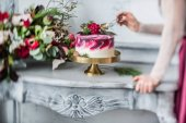 woman eating wedding cake with flowers