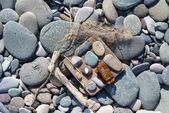 Fotografie šedý oblázkové kameny na pláži, zblízka