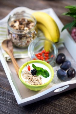 Bananas with gorp in jar and cereal in bowl