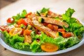 Fotografie Chicken Salad on background
