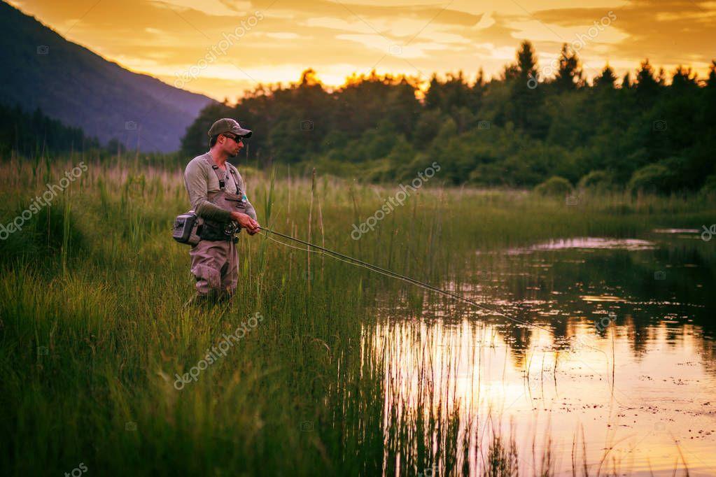 Fly fisherman fishing pike