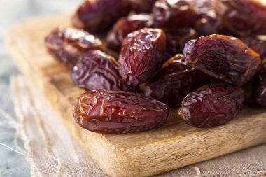 dried dates  on cutting board