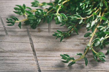 thyme on a wooden background. Macro
