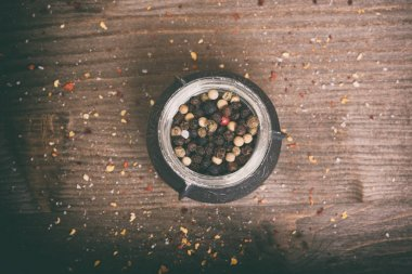 Spices. black peppercorns on wooden table