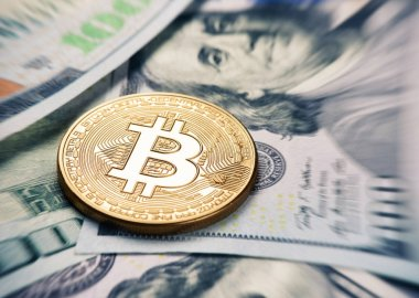 Bitcoin coin on a us dollar currency
