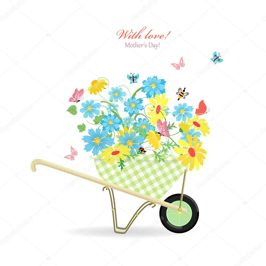 cute garden wheelbarrow with wild flowers