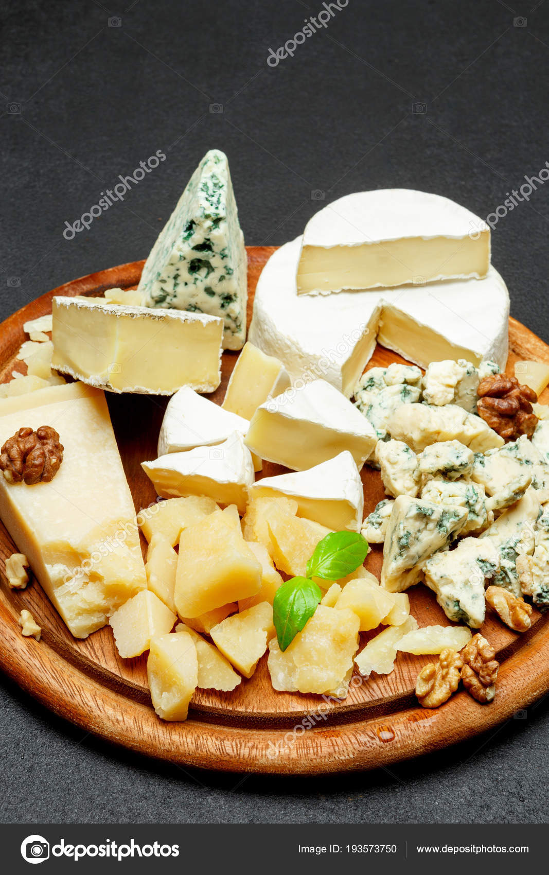 Cheese plate with Assorted cheeses Camembert Brie Parmesan blue cheese goat \u2014 Stock & Cheese plate with Assorted cheeses Camembert Brie Parmesan blue ...