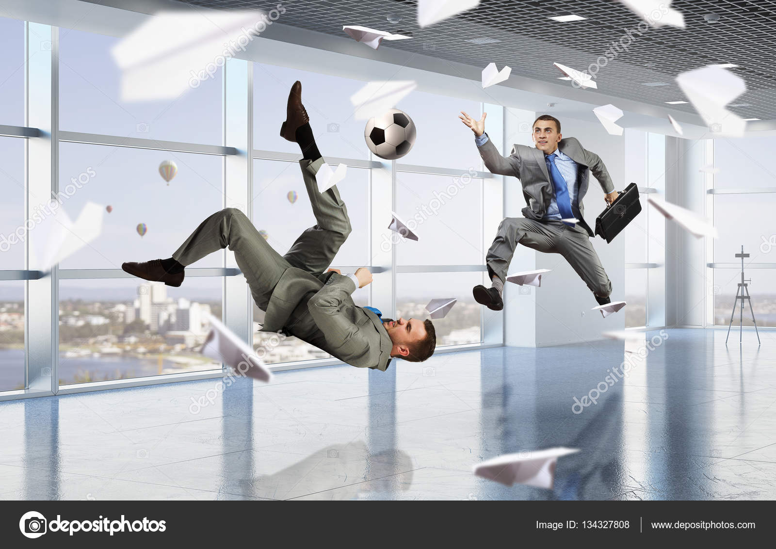 playing office soccer mixed media stock photo