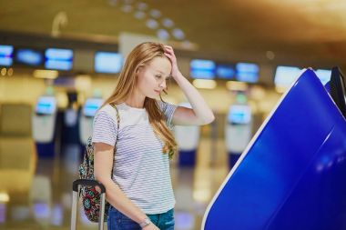 Tourist girl with backpack in international airport