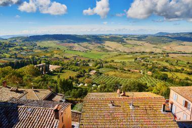 Scenic Tuscan landscape with beautiful fields, meadows and hills. San Quirico d'Orcia, Tuscany, Italy stock vector