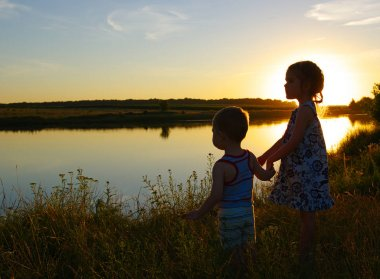 little boy and girl in the field