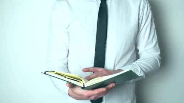 Businessman looking through his diary