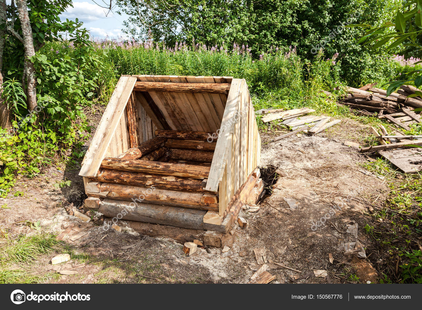 Construction new wooden water well in russian village in summert ...