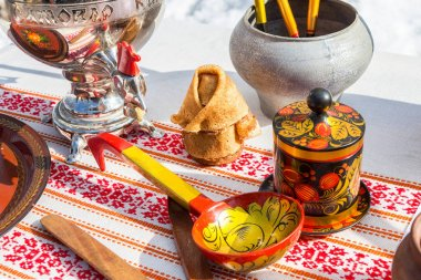 Different products of Russian folk art on the pancake week or ma