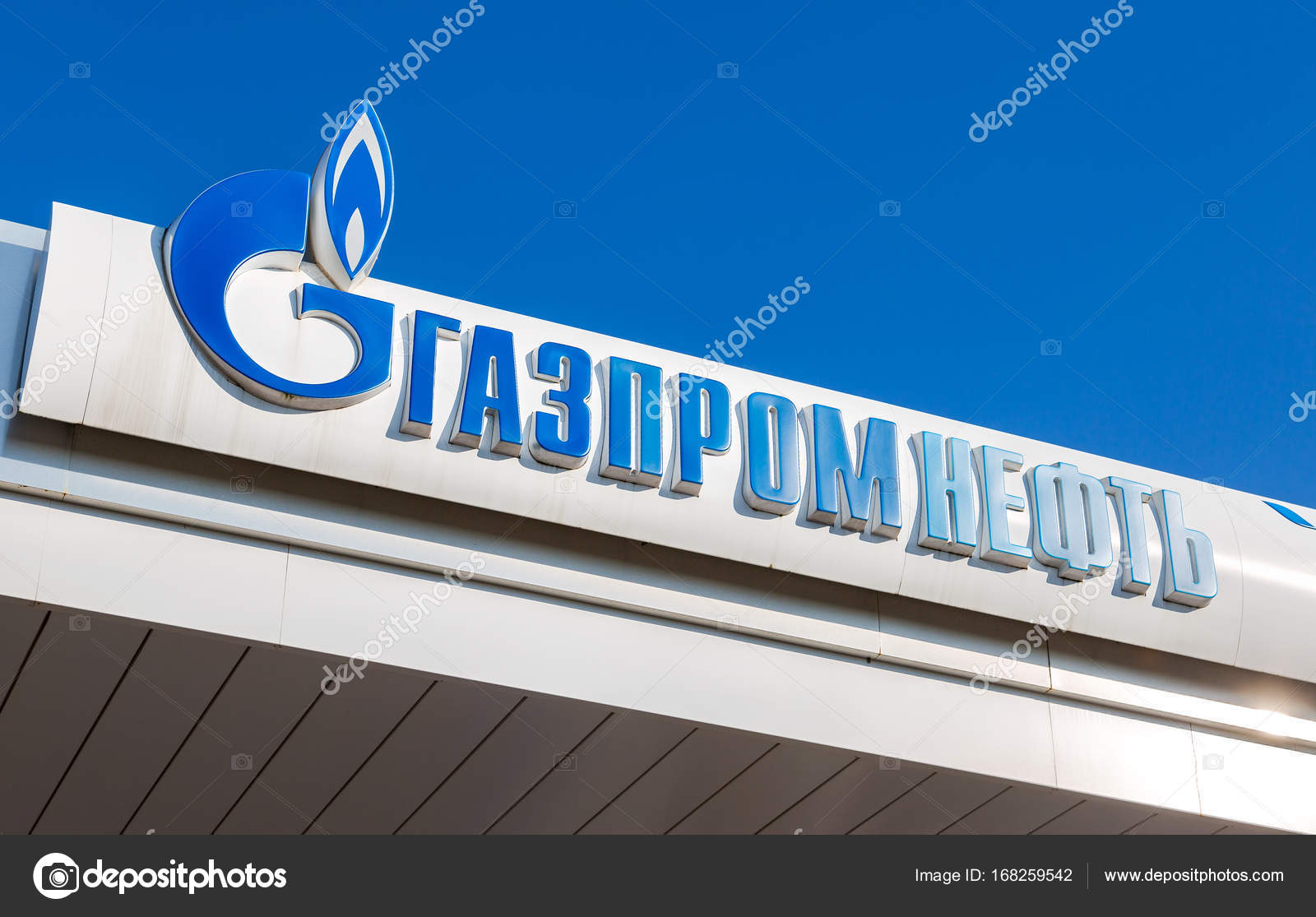 The emblem of the oil company Gazpromneft on the gas station