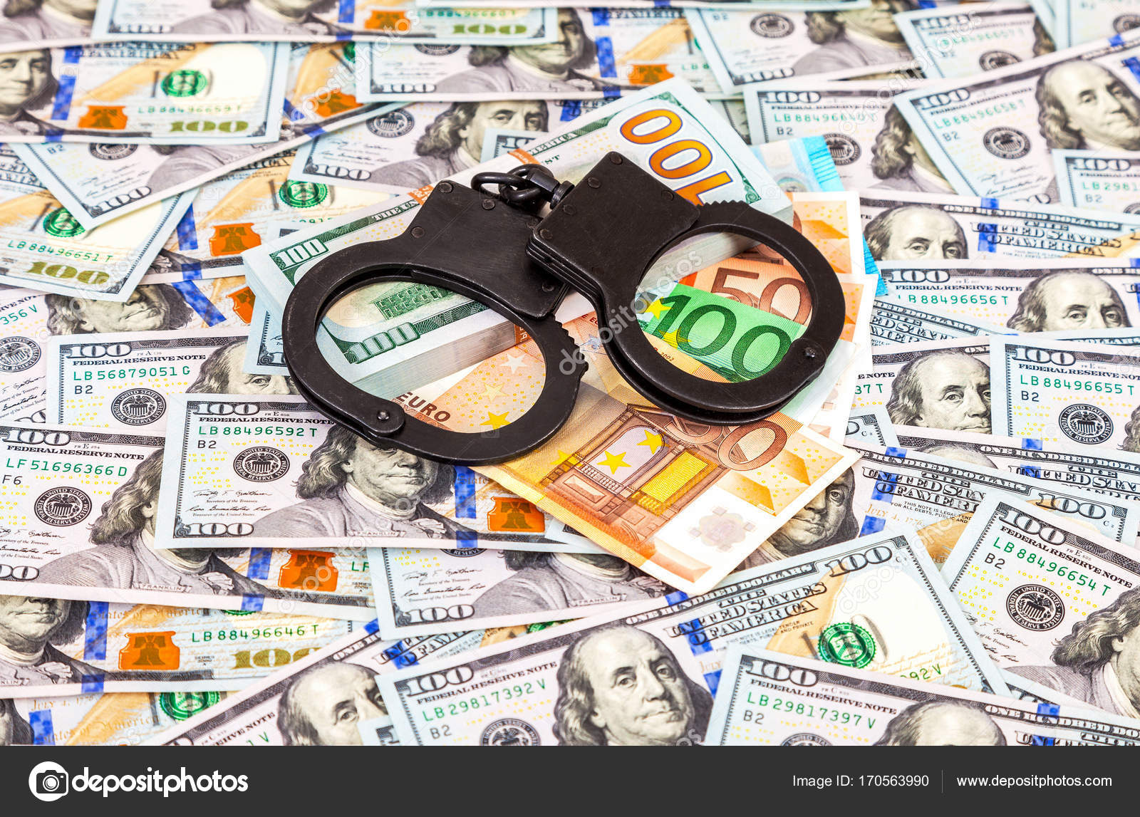Steel Police Handcuffs Lying On The American Dollars And Euro Ba Stock Photo