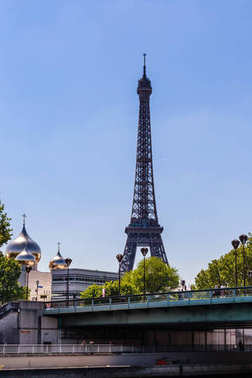 PARIS, FRANCE - MAY 11, 2017:   Eiffel Tower. Holy Trinity Cathedral and The Russian Orthodox Spiritual. Pont de l'Alma.  Paris