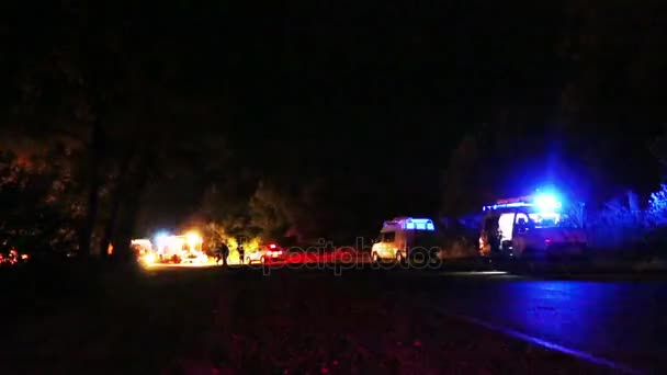 Night time accident scene with emergency vehicles and ambulance in the  background