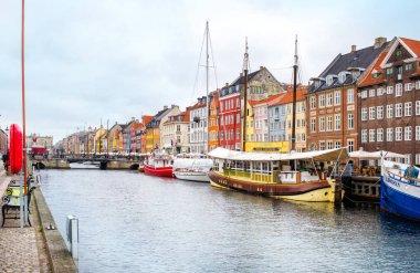 Copenhagen, Denmark - MARCH 29, 2017: View of Nyhavn channel colorful houses stock vector