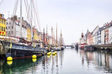 Copenhagen, Denmark - MARCH 30, 2017: Nyhavn is a 17th-century waterfront, canal and entertainment district in Copenhagen, Denmark. stock vector