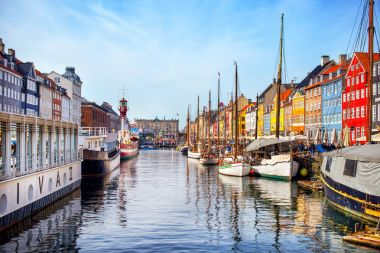 Copenhagen, Denmark - MARCH 31, 2017: View of Nyhavn canal and colorful houses stock vector