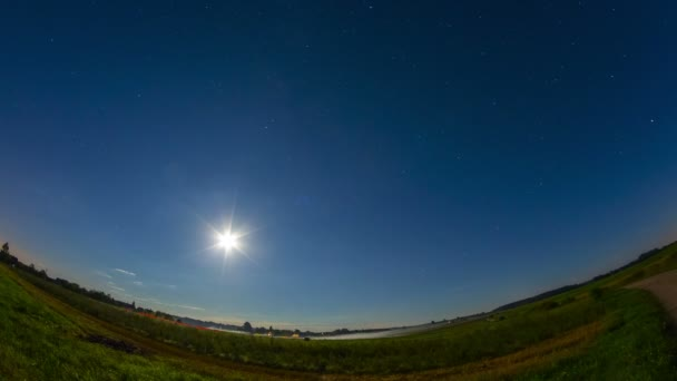 Night rural landscape with moon and stars, 4k time-lapse