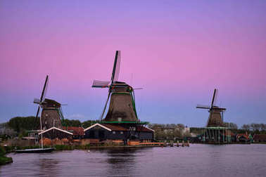 Windmills at Zaanse Schans in Holland in twilight after sunset.
