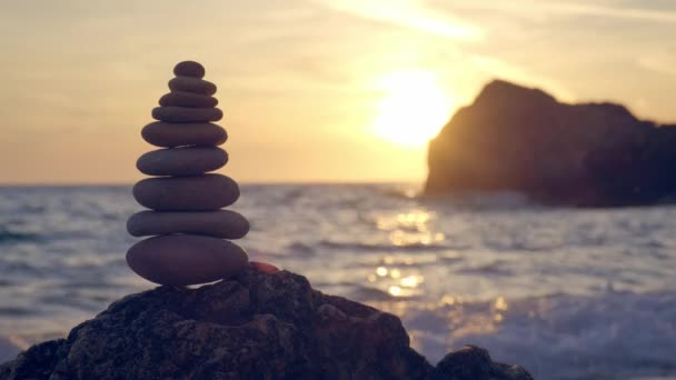 Concept of balance and harmony - stone stacks on the beach
