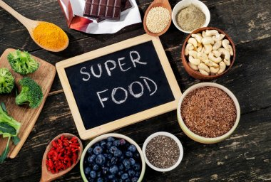 Super foods on a rustic wooden background.