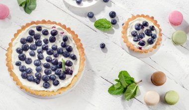 Cakes with blueberries and whipped cream