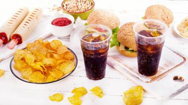 Fast food and cola in plastic cups