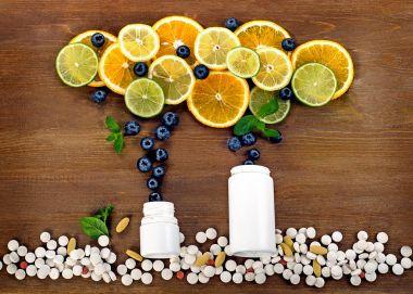 Fresh citrus fruits and pills