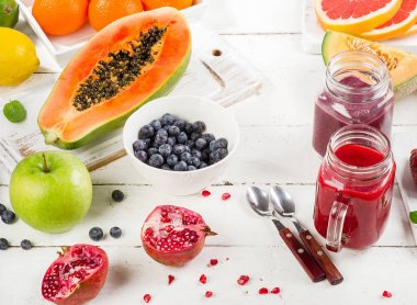smoothies with fruits and bowl with blueberries