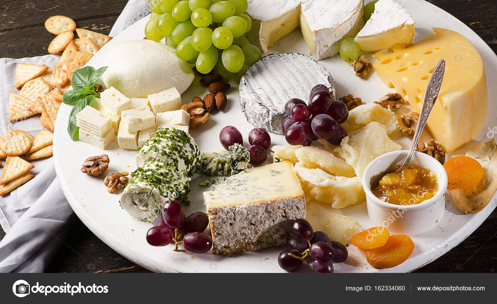 Cheese plates served with grapes jam and nuts on a wooden board. Top view u2014 Photo by bit245 & Cheese plates served with grapes jam and nuts u2014 Stock Photo ...