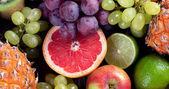 Gyümölcsök háttér. Egészséges ételek fogalmát. Szemközti nézet